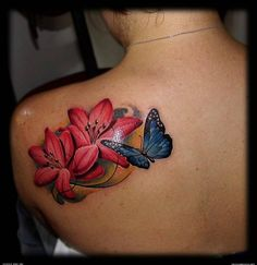http://tattoomagz.com/butterflies-tattoos-on-shoulder/red-flowers-and-butterfly-tattoo-on-shoulder/