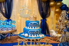 Blue and gold cake at a prince birthday party! See more party planning ideas at CatchMyParty.com!