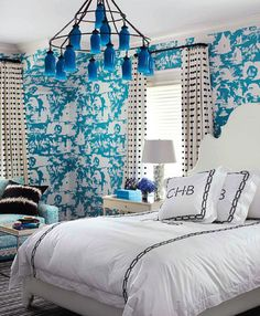 the walls, the curtains and the bedding. blue and white dreamy bedroom. light fixture ~ monogrammed pillows ~ interior design.