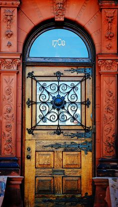 Interesting wrought iron details on this door in Philadelphia, Pennsylvania.
