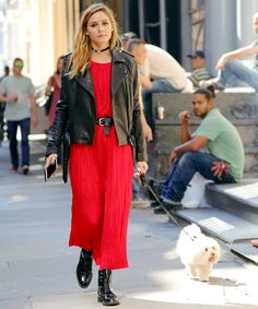 The brunette beauty was spotted walking her adorable dog Mr. Butler, and she looked like she was ready to hit the runway in a chic biker-esque ensemble. See it here.