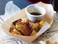 """Salt and Vinegar Potato Bites  3 C yellow potatoes cut into 1"""" cubes (about 6 med,)  2 T oil,  1 C malt vinegar,  3 T sugar  Directions: 1) Soak potatoes in large bowl of cold water for 30 min. Drain and pat dry. 2) Toss potatoes with oil on baking sheet and spread in a single layer. Roast 45 min at 425, until golden and crisp, turning once or twice. 3) Bring vinegar and sugar to a simmer over med heat, cook until reduced by half, 15-20 min, stirring occasionally. 4) Serve on the side or…"""