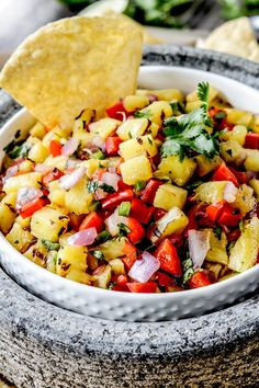 The only thing missing from this tropical salsa is a pina colada on the side. Get the recipe from Carlsbad Cravings.   - Delish.com