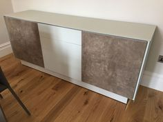 BOOK matt glass frame modular sideboard. Modules of two doors with ceramic fronts and set of drawers with matt glass fronts. Delivered to our client in London.