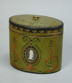 George III oval green papier mache tea caddy probably by Henry Clay with Wedgwood medallions