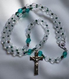 Economy Rosaries, can be ordered in bulk with price break.Great for kiddos, schools, or churches. I have enough supplies to make 101 of these for the Kiddos. Follow link to AllToolsPrayerful on Etsy.