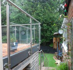 Side mounted framed glass balustrade design balcony extension roof.