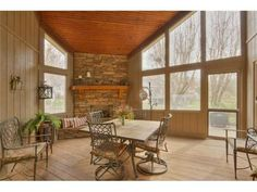 """Adding a wood floor (or wood-look tile, beadboard ceilings & a stone fireplace would warm up an otherwise stark """"Florida-looking"""" sunroom!"""