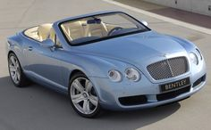 Bentley Continental. Gorgeous. I believe I would gray a lot more gracefully if I had one of these in my driveway!!
