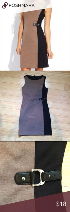 Sleeveless Dress Business Casual Premise Dresses black and tan form fitting dress. Just above knee length. Worn about 4 times. Shell: 69% Polyester, 27% Rayon, 4% Spandex. Lining: 100% Polyester. Premise Dresses Dresses