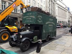 Old school: A vintage lorry waited by the scene filled with a multitude of furniture