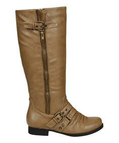 Anytime is a good time for boots! This classic pair includes decorative buckles and slight stacked heel to show off sweet style.1.25'' heel14.5'' shaft16'' circumferenceZipper closureMan-madeImported