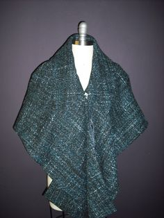 1960s inspired capelet made from an Italian wool blend fabric.