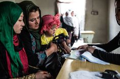 Despite Taliban threats and attacks on the presidential election, a woman registered to vote in Kabul, Afghanistan, using her fingerprint. (Photo: Bryan Denton for The New York Times)