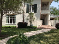 red flatwork brick w/extra morter/white square columns/white back porch ceiling/gas lamps