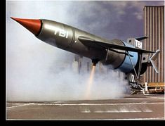 Thunderbird 1 lands at disaster site.