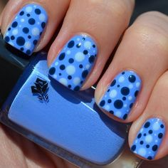 This nail art features a gorgeous aqua blue polish as base and a polka dot design of different shades of blue polish. Get the must-have products used to DIY this manicure.