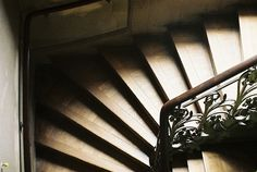 beautiful iron work on the stairs, nice woodwork design as well.