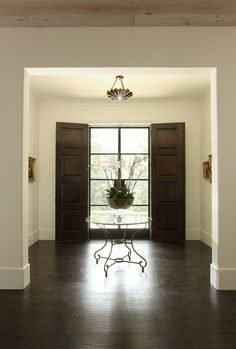 Double front doors, one set in steel and one in wood provides the best of both worlds. Hedgewood custom home. Double Front Doors, Interior Architecture, Interior Design, House Doors, Front Entrances, Entry Hall, Windows And Doors, Building Design, Custom Homes