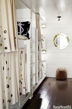 """The bunk room in a 1,650-square-foot Marin County, California house, designed by Erin Martin and owner Kim Dempster, feels like a ship's cabin and is lined with six bunks, four on one side and two on the other. The small space becomes useful when having guests over. """"If we have another family visiting, either all the kids go down and the parents go up, or the whole family sleeps in the bunk room,"""" Dempster says. """"Kids just love that room, and they'll hang out down there when it's not…"""