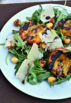 Arugula with grilled peaches, hazelnuts, shaved Parmesan in a Balsamic vinaigrette - Italian-inspired summer salad.