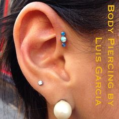 Forward helix piercing on @knl792 with Anatometal opal triple gem cluster (at NoKaOi Tiki Tattoo and Piercing)