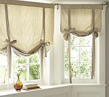 Pottery Barn ticking stripe ribbon-tie curtain. Making these w/different fabric, breezy weight solid color.