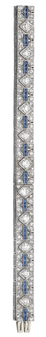 SAPPHIRE AND DIAMOND BRACELET,  CIRCA 1925.   The band of geometric design, pierced and millegrain-set with calibré cut sapphires, circular- and single-cut diamonds, length approximately 185mm.