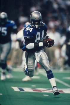 Wide receiver Joey Galloway of the Seattle Seahawks runs upfield with a reception against the Denver Broncos at the Kingdome in Seattle Washington on. Seattle Seahawks, Denver Broncos, Pittsburgh Steelers, Football Images, Sports Images, Seahawks Pictures, Evergreen State, Tight End, School Football