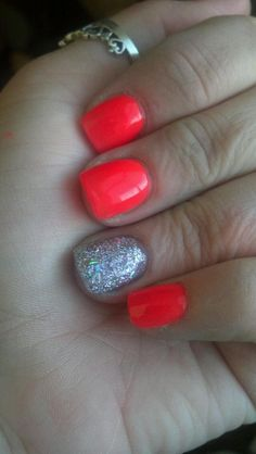 Silver accented neon nails.