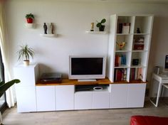 The IKEA Kallax line Storage furniture is an important part of any home. Stylish and wonderfully easy the corner Kallax from Ikea , for example. White Tv Stand Ikea, Ikea Lack Tv Stand, Ikea Stand, Dresser With Tv, Dresser Tv Stand, Ikea Tv, Ikea Kallax, Kallax Hack, Ikea Desk