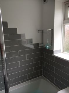 Stunning Linear grey brick-style tiles from Topps Tiles  Designed and Installed by AQUANERO Bathroom Design & Installation  AQUANERO.co.uk