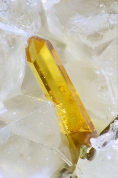 Titanite : CaTi(SiO4)O Bassano Romano, Viterbo Province, Latium, Italy Beautiful elongated titanite crystal in sanidinitic xenolith rock.