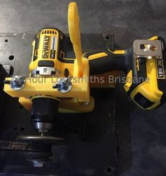 dewalt drill in 3D printed clamp with pully attached
