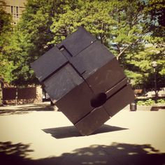 A 15-foot-tall, 2400-lb glossy black cube created by Tony Rosenthal; there's an identical one in the East Village of New York City. The Cube spins on its axis when pushed.
