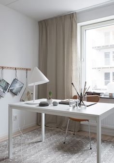 home-office-warm-beige-and-grey-tones   This modern Scandinavian style apartment is a display home in suburban part of Stockholm styled by talented Marie Ramse for JM. Sand tones and fray-green match perfectly and combined with lots of white give the space light and warm feel.