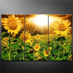 I love the bold and bright sunflowers in this divine piece of floral wall art.  This would add so much color to any room.  I love how eal it looks.  I feel like I am in the field of flowers.  Floral Wall Art - How to Decorate using Floral Wall Art