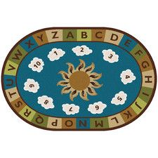 Blue Sunny Day Learn and Play Area Rug-After looking at literally hundreds of rugs this one is by far my favorite. Soothing neutral colors keeps the kiddos at ease while stimulating the senses with numbered seating areas and an alphabet trim. Visually engaging without the distraction of vibrant colors and busy patterns. I don't know about your little ones but mine have more than enough energy! This is a family favorite calming color palate and design.