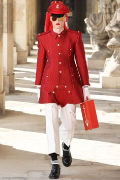 SPRING 2014 MENSWEAR Thom Browne / Thom Browne has wanted to do a military collection for a while. He waited patiently while the rest of fashion flirted with the idea. Camo everywhere. Then he came across the École Militaire in Paris, which looks more like the Palace of Versailles than a military academy. Eureka! Thom got in touch with his inner Private Browne.