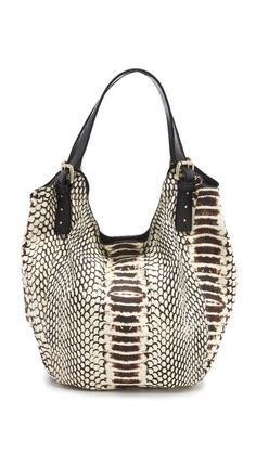 Snakeskin print lends cool, carefree glamour to this casual canvas shoulder-bag.     Weight: 27oz / 0.76kg.