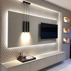 5 Amazing Ways to Upgrade Your Living Room TV Wall - Are you bored with the same old flat screen arrangement? Then why not try one of these five amazing ideas for your living room TV wall. Living Room Tv Unit Designs, Ceiling Design Living Room, Tv Wall Design, Kitchen Room Design, Home Room Design, Room Kitchen, Kitchen Designs, Tv Unit For Living Room, Living Room Ideas Tv Wall