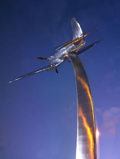 Pictures and info on The Darwen Spitfire Memorial manufactured by our WEC Academy apprentices and donated to the town. - Stainless Steel Fabrication by m-tec Stainless Steel Fabrication, Metal Fabrication, Area Of Expertise, Abstract Sculpture, Public Art, Wind Turbine, Metal Working, Fighter Jets, Memories
