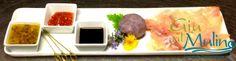 Sashimi di orata alle tre salse con patata viola
