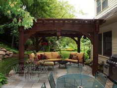 Free standing pergola with Rich Cordoba stain and Roosevelt profile. Upgraded wrap around roof, arched beams, and teardrop keystones.