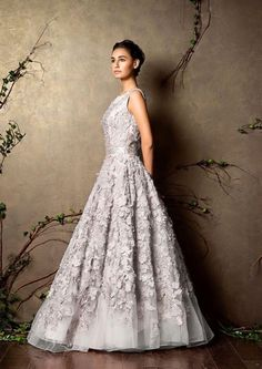That pretty Shyamal and Bhumika silver net gown with floral cutwork <3…