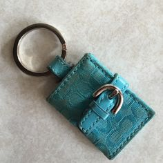 Coach keychain AUTHENTIC Coach real keychain. Slight signs of wear in coloration of fabric. 2 picture slots in keychain Coach Accessories Key & Card Holders