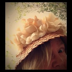 Vintage Summer wicker hat with huge Spring roses Back in the day this gorgeous woven hat would be worn to only special events. The brim is adorned with four huge roses. The outer band is cream colored velvet ribbon. The inner band is cream Grosgrain ribbon. There is a partial original sales tag. Comes from my smoke free home. Vintage. Viva Las Vegas. Style for your retro image. Vintage Accessories Hats