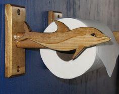 bottle-nosed dolphin toilet tissue holder for a beach house bathroom