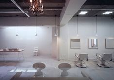 Japanese architect Makoto Yamaguchi has created a hair salon in the basement of a Tokyo building, showcasing the patchwork of alterations made by previous occupants of the space. Called kilico., the project involved patching the floor to make it flat and coating the various textures of the walls with white paint. White furniture, lighting and More