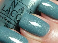 "opi ""i have a herring problem"" - dusty blue-green base with silver/gold shimmer:"